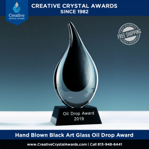 hand blown black art glass oil drop award for energy industry
