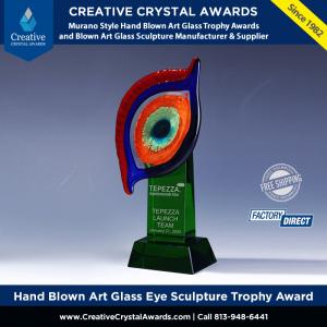 hand blown green art glass eye sculpture trophy Murano glass eye award